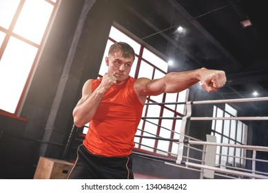 Float like a butterfly, sting like a bee. Focused muscular athlete in sports clothing keeping an opponent out of reach