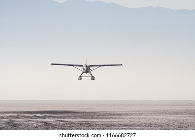 A float plane flies away from Victoria, British Columbia, shortly after takeoff