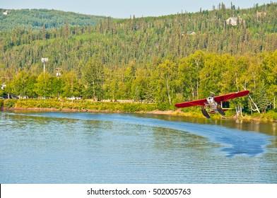 Float plane taking off from a river in Fairbanks, Alaska