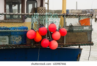 Floatation buoys and netting on back of fishing boat in Littlehampton Harbour, West Sussex, England