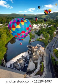 Floating above the ground through a hot air balloon festival.