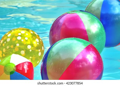 Floating beach balls.