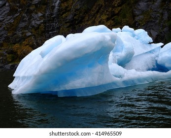 Floating blue ice fragment calved from the Sawyer Glacier near Juneau, Alaska