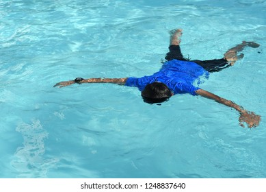 floating body of a drowned male children in swimming pool. concept of safety