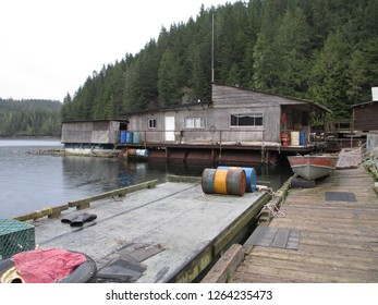 A floating camp on the Pacific Coast in British Columbia. Logger using this camp to reduce the need for commuting to the nearest town some 30 miles away. The wooden buildings are rough and weathered.