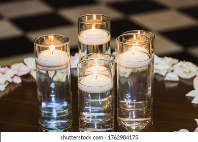 Floating candle centerpiece sitting on a table