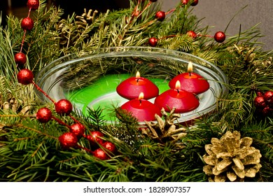 Floating candles with Advent wreath.