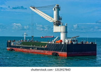 Floating Crane Transhipper with grab feeding system to cater to bauxite ore transhipment operations from barges at outer anchorage of Port Kamsar, Republic of Guinea.