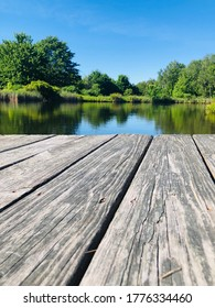 Floating dock on the pond in the summer - Shutterstock ID 1776334460