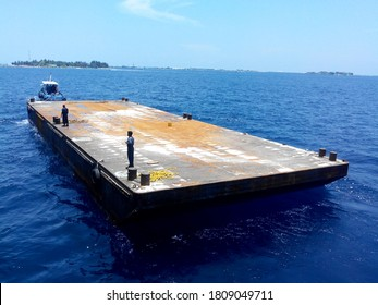 A floating dock, floating pier or floating jetty is a platform  that joins the shores with gangway of ship or where there no dock is available , this floating dock csn be used.