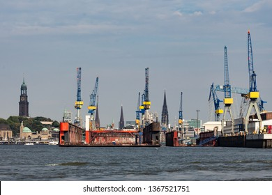 Floating dock in the port of Hamburg with tower of famous church Michel in the background
