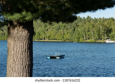 Floating docks on a lake in Ontario Canada's Cottage Country on a summer evening.