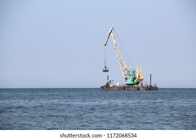 floating excavator cleans  bottom