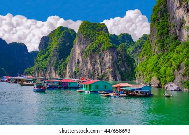 Floating fishing village near rock islands in Halong Bay, Vietnam, Southeast Asia. UNESCO World Heritage Site.