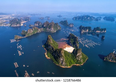 Floating fishing village and rock island in Bai Tu Long bay, Vietnam, Southeast Asia. UNESCO World Heritage Site. Landscape. Popular landmark, famous destination of Vietnam. Near Ha Long bay