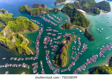 "Floating fishing village and rock island in "" Lan Ha "" Bay, Vietnam, Southeast Asia. UNESCO World Heritage Site. Landscape. Popular landmark, famous destination of Vietnam. Near "" Ha Long "" bay"