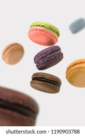 Floating french macarons on white background