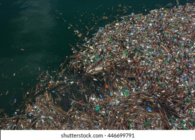 Floating garbage in polluted, toxic water