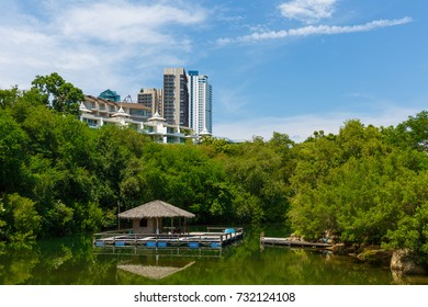 Floating gazebo in the pond and the modern buildings in Pattaya, Thailand