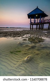 Floating gazebo at sunset with pattern of sand as foreground. This photo was taken dampo awang beach, rembang, central java, indonesia