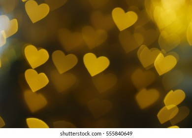 Floating gold heart shape bokeh background