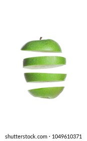 Floating green apple slices isolated on a white background