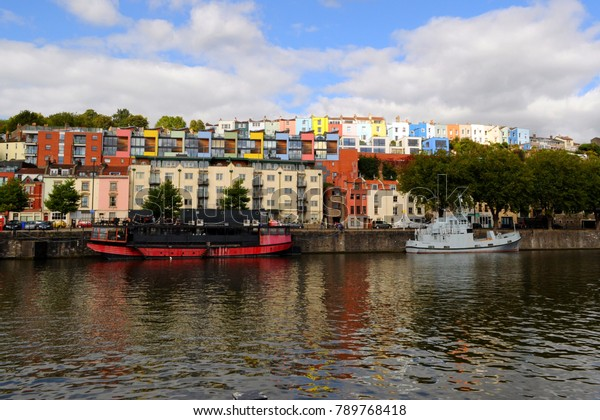 Floating Harbour, Bristol / UK - 09/25/15: Grain Barge restaurant and 'Pride of Bristol' moored by Hotwell Road.