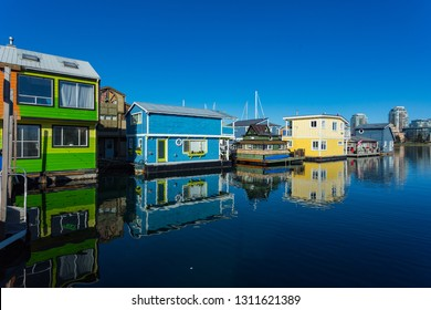 Floating Home Village Houseboats Fisherman's Wharf Inner Harbor, Victoria British Columbia Canada.Area has floating homes, boats, piers, restaurants and adventure tours