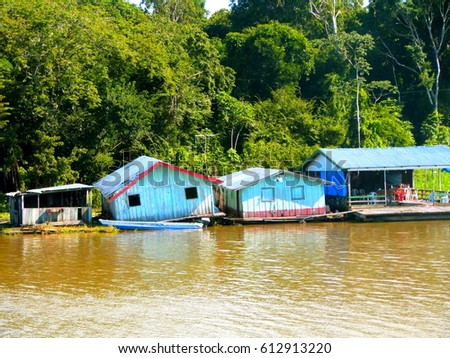 d2e8e6123ad Floating houses over Amazon River in time of floods with lush forest in the  background. Taken in Amazonian rivers near Manaus