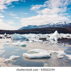 Floating ice box on the Fjallsarlon glacial lagoon. Sunny morning scene in Vatnajokull National Park, southeast Iceland, Europe. Artistic style post processed photo.