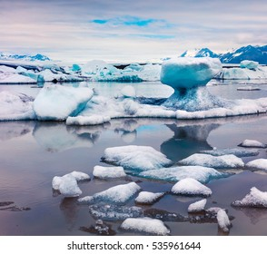 Floating ice box on the Fjallsarlon glacial lagoon. Bright morning scene in Vatnajokull National Park, southeast Iceland, Europe. Artistic style post processed photo.