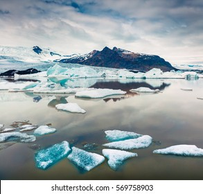 Floating ice box on the Fjallsarlon glacial lagoon. Frosty summer morning in Vatnajokull National Park, southeast Iceland, Europe. Artistic style post processed photo.