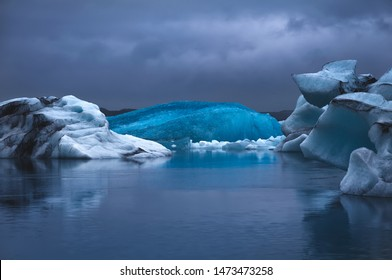 "Floating ice in Jokulsarlon lagoon, Iceland. Jokulsarlon (literally ""glacial river lagoon"") is a large glacial lake in southeast Iceland, on the edge of Vatnajokull National Park"