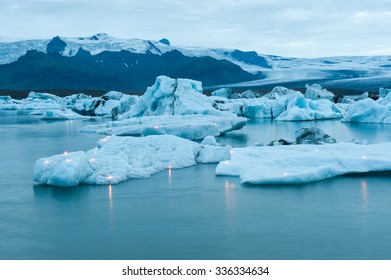 Floating icebergs with candles, Jokulsarlon ice lagoon before annual firework show, Iceland