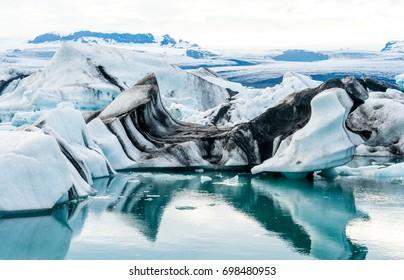Floating icebergs in the glacial lake Jokulsarlon in Iceland