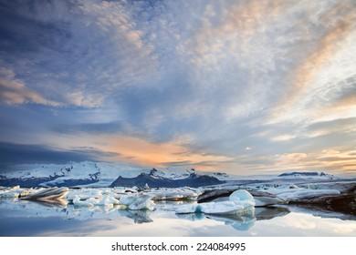 Floating icebergs in Jokulsarlon Glacier Lagoon during sunset