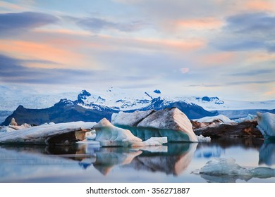 Floating icebergs in Jokulsarlon Glacier Lagoon during sunset