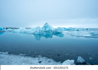 Floating icebergs in a water lagoon at Jokulsarlon Lagoon in South Iceland.