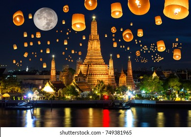Floating lamp in yee peng festival under loy krathong day at wat arun, Full moon at night in bangkok city, Thailand