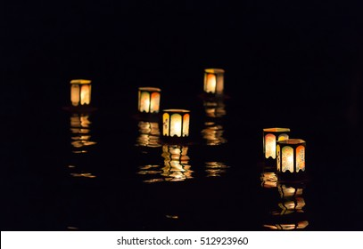 Floating lantern ceremony in Haleiwa on the island of Oahu Hawaii.  Lanterns are lit after the O-bon dance and placed in the Ocean to honor the Ancestors of the participants.