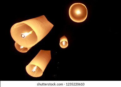 Floating Lantern, Yi Peng Festival into the Night Sky. Loi Krathong coincides with the Lanna (northern Thai)