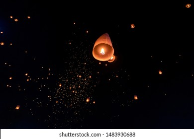 Floating lanterns on sky in Loy Krathong Festival or Yeepeng Festival , traditional Lanna Buddhist ceremony in Chiang Mai, Thailand