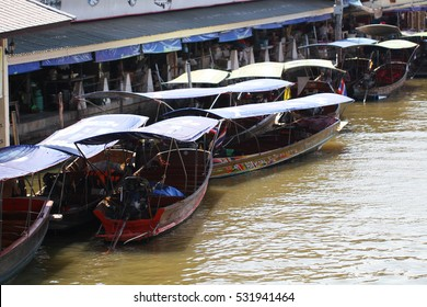 Floating market in Bangkok, tourists boat trip in river of Thailand