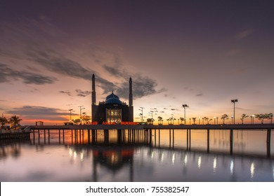 The floating mosque Amirul Mukminin at south Sulawesi Indonesia when cloudy gold sunset in losari beach