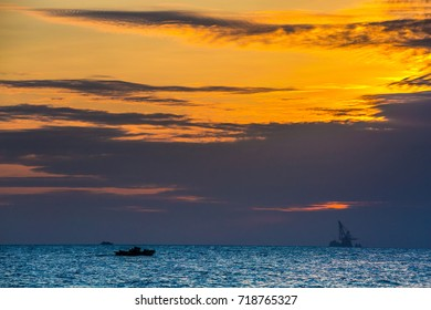 Floating oil platform on sea sunset. Hainan, China.