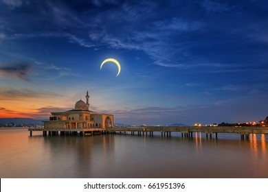 Floating Penang Port mosque during crescent moon and golden sunset