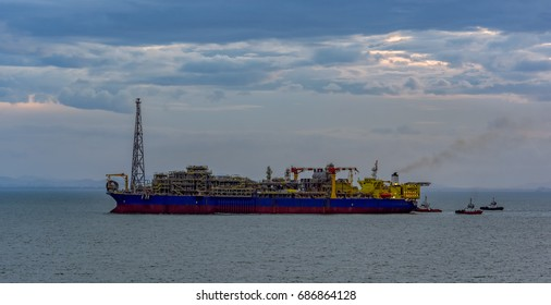 Floating production, storage and offloading (FPSO) vessel for oil and gas treatment with tugboats at the South China sea