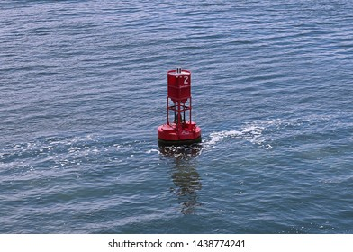 Floating red buoy in the river showing navigation and directions