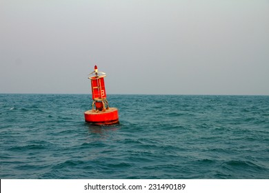 Floating red navigational buoy on blue sea,gulf of Thailand.
