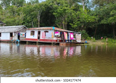 Floating river houses along the Amazon River in the province of Amazonas in Brazil, South America